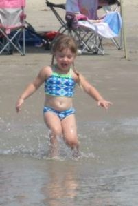 Ainsley is running to Mommy!